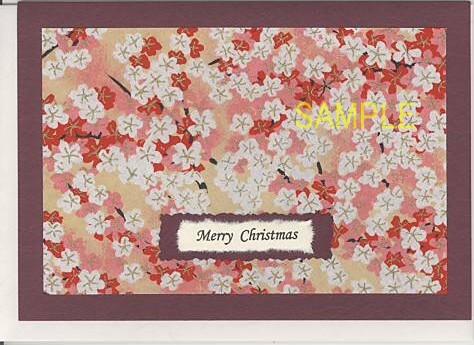 おもて表紙に紅白の花が描かれた和紙をあしらったクリスマスカードです。