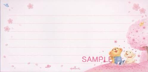 桜に囲まれたリトとコロを描いた一筆箋です。